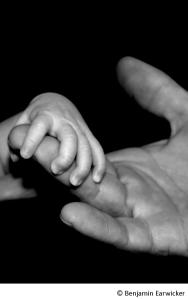 dad and baby hands incl copyright
